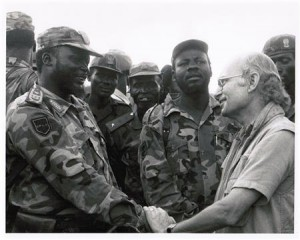 Handout photo of John Garang shaking hands with Roger Winter in this undated image taken in Sudan